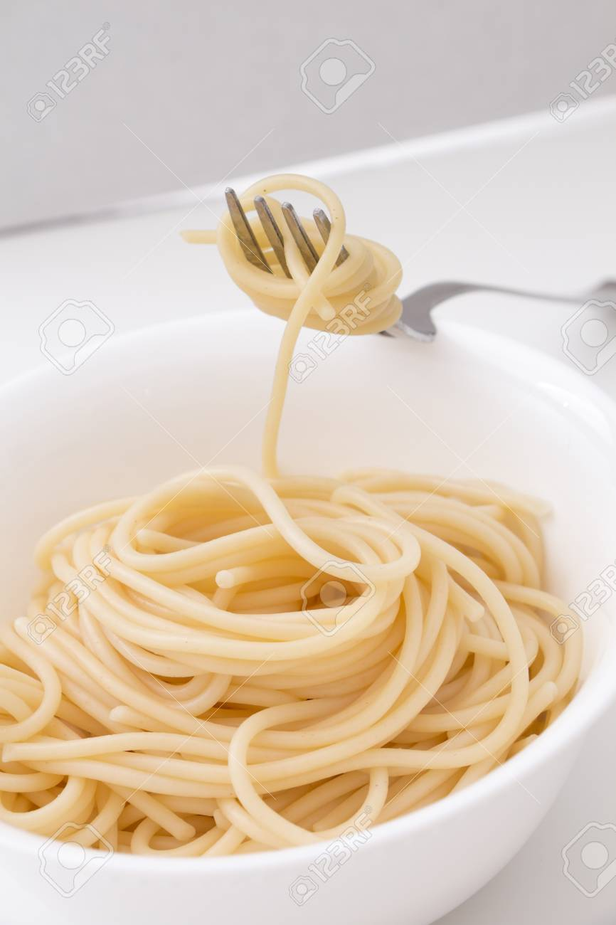 Plain Cooked Spaghetti Pasta In White Bowl And On Fork, On White ...
